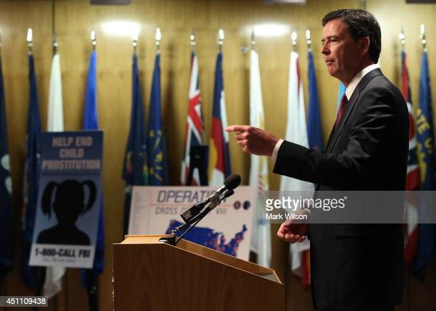 Director James Comey speaks during a news conference on child sex trafficking at FBI headquarters June 23 2014 in Washington DC Director Comey said...