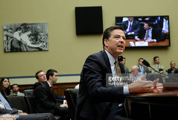 FBI Director James Comey testifies before a House Oversight and Government Reform Committee hearing on Capitol Hill in Washington DC on July 7 2016...