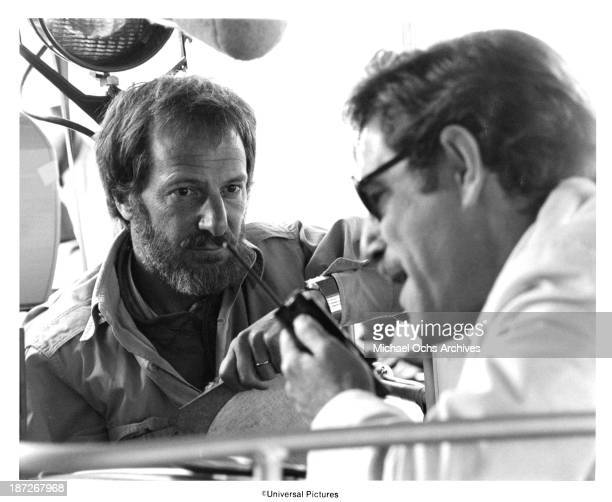 Director James Goldstone behind the scenes with George Segal on the Universal Pictures movie Rollercoaster in 1977