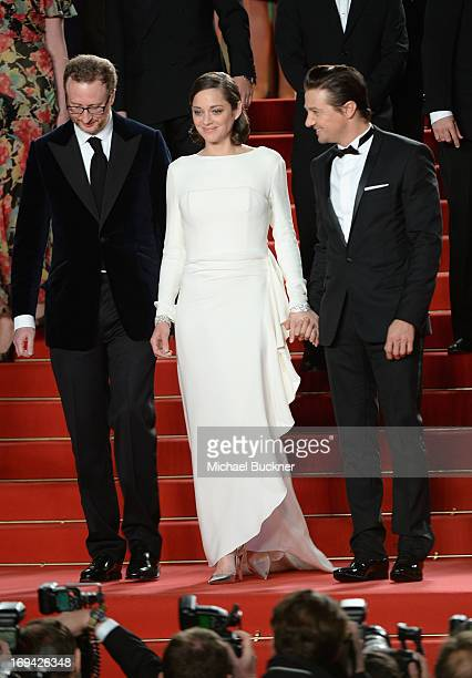 Director James Gray actors Jeremy Renner and Marion Cotillard leave 'The Immigrant' Premiere during the 66th Annual Cannes Film Festival at Grand...