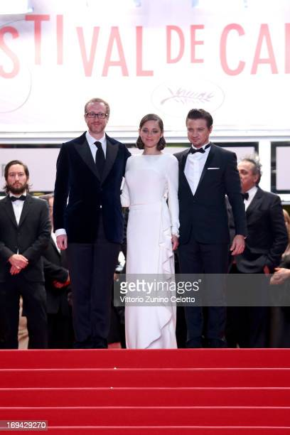 Director James Gray actors Marion Cotillard and Jeremy Renner leave 'The Immigrant' Premiere during the 66th Annual Cannes Film Festival at Grand...