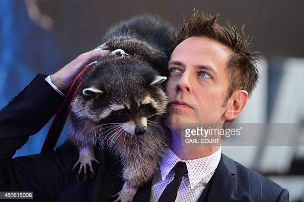 US director James Gunn and a racoon attend the European premiere of the film Guardians of the Galaxy in central London on July 24 2014 AFP PHOTO /...