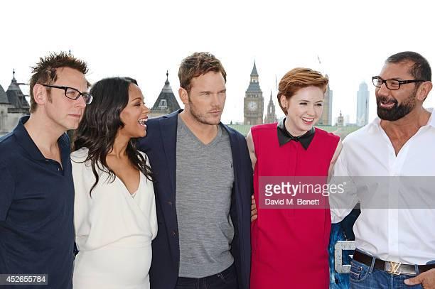 Director James Gunn and cast members Zoe Saldana Chris Pratt Karen Gillan and David Bautista pose at the Guardians of the Galaxy photocall at The...