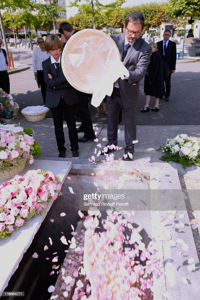 Director James Huth put flowers on the coffin of his father, President of FIFA protocol Doctor Pierre Huth during his Funeral in Nogent Sur Marne cemetery on August 30, 2013 in Nogent-sur-Marne, France.
