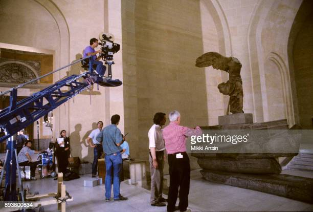 Director James Ivory directs Cinematographer Tony PierceRoberts while filming 'Mr and Mrs Bridge' in front of the Winged Victory in the Louvre in...