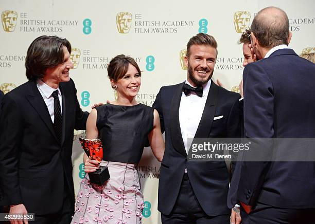 Director James Marsh Felicity Jones and presenter David Beckham celebrate the Outstanding British Film award going to The Theory Of Everything in the...