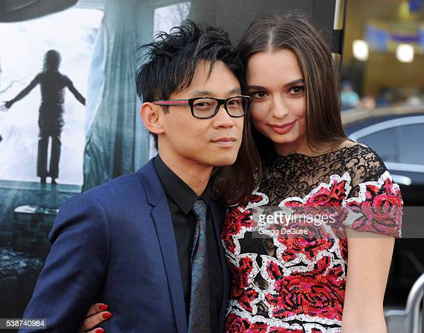 Director James Wan and actress Ingrid Bisu arrive at the 2016 Los Angeles Film Festival The Conjuring 2 Premiere at TCL Chinese Theatre IMAX on June...