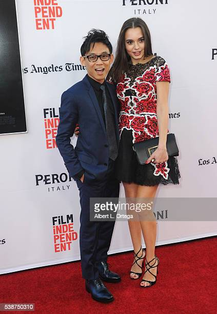 Director James Wan and actress Ingrid Bisu arrives for the premiere of The Conjuring 2 as part of the 2016 Los Angeles Film Festival held at TCL...