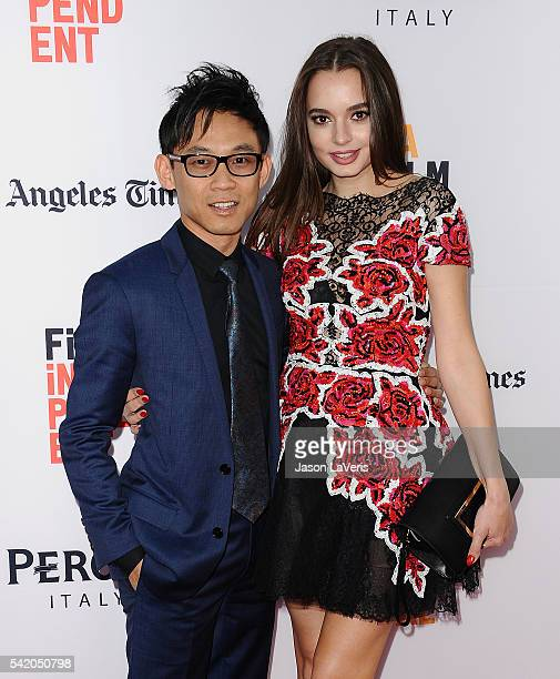 Director James Wan and actress Ingrid Bisu attend the premiere of The Conjuring 2 at the 2016 Los Angeles Film Festival at TCL Chinese Theatre IMAX...