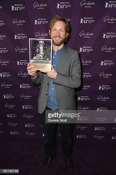 Director Jan Speckenbach poses with his 'Made In Germany' Award during an event for Glashuette during the 63rd Berlinale International Film Festival...