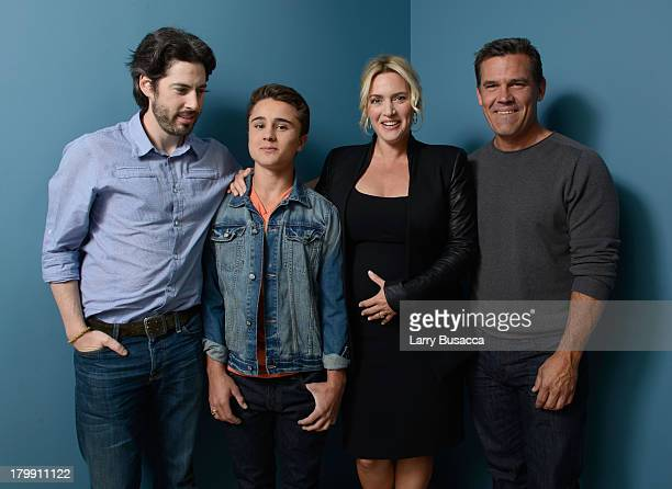 Director Jason Reitman actor Gattlin Griffith actress Kate Winslet and actor Josh Brolin of 'Labor Day' pose at the Guess Portrait Studio during 2013...