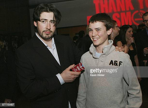 Director Jason Reitman and actor Cameron Bright sample the candy cigarettes at the afterparty for the premiere of Fox Searchlight's Thank You For...