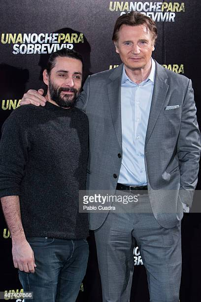 Director Jaume ColletSierra and actor Liam Neeson attend the 'Run all night' photocall at the Santo Mauro Hotel on March 24 2015 in Madrid Spain