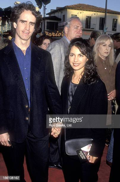 Director Jay Roach and Musician Susanna Hoffs of The Bangles attend 'The Fugitive' Westwood Premiere on July 29 1993 at Mann Village Theatre in...