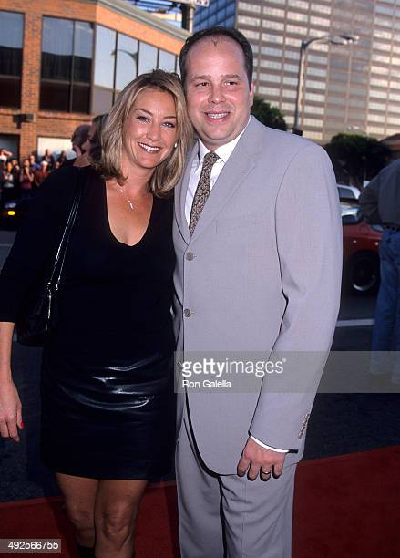 Director JB Rogers and wife Gwendolyn attend the 'American Pie 2' Westwood Premiere on August 6 2001 at the Mann National Theatre in Westwood...