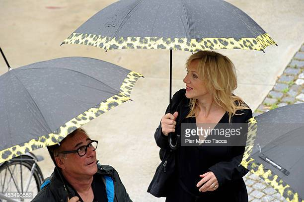 Director Jean Jacques Zilbermann and Actress Johanna Ter Steege attend the 'A La Vie' Photocall during the 67th Locarno Film Festival on August 11...