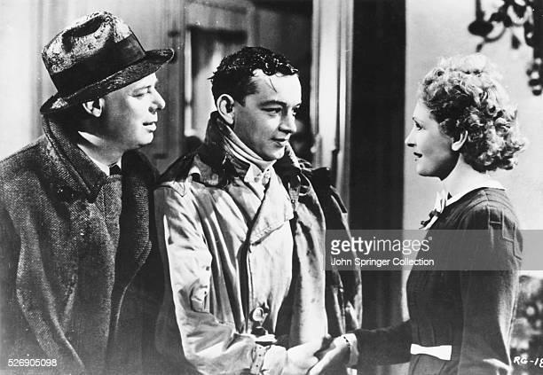 Director Jean Renoir as Octave Roland Toutain as Andre Jurieux and Nora Gregor as Christine de la Cheyniest in the 1939 French film La Regle du jeu
