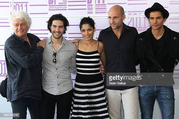 Director JeanJacques Annaud actors Tahar Rahim Freida Pinto Mark Strong and Jan Uddin attend the Black Gold photocall at the Press Centre during day...