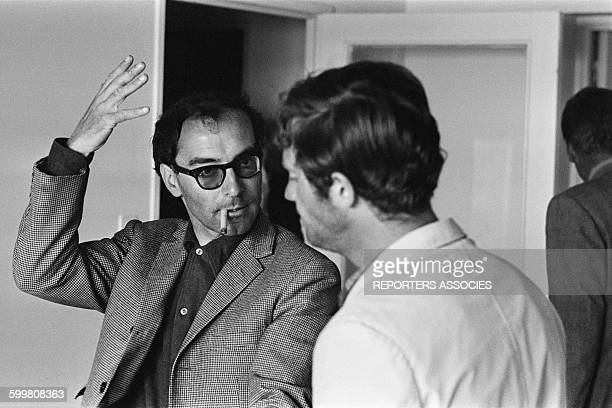 Director JeanLuc Godard And Actor JeanPaul Belmondo On The Set Of The Movie 'Pierrot Le Fou' in Hyères France in June 1965