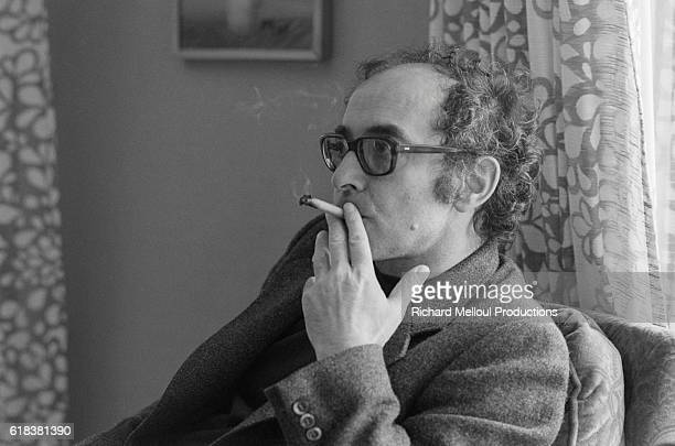 Director JeanLuc Godard smokes a cigarette during the 1980 Cannes Film Festival He is participating at Cannes for the first time with his film Sauve...