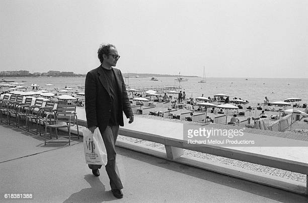 Director JeanLuc Godard walks along the beach during the 1980 Cannes Film Festival He is participating at Cannes for the first time with his film...