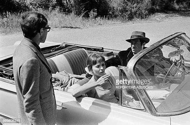 Director JeanLuc Godard With Anna Karina And JeanPaul Belmondo On The Set Of The Movie 'Pierrot Le Fou' Directed By JeanLuc Godard in Hyères France...