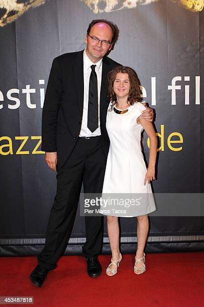 Director JeanPierre Ameris and Actress Ariana Rivoire attend the 'Marie Heurtin' photocall premiere during the 67th Locarno Film Festival on August...