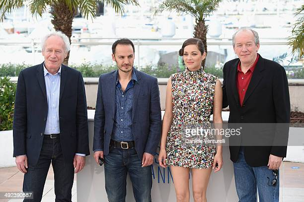 Director JeanPierre Dardenne actor Fabrizio Rongione actress Marion Cotillard and director Luc Dardenne attend the 'Two Days One Night' Photocall...