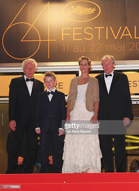 Director JeanPierre Dardenne actor Thomas Doret actress Cecile de France and director Luc Dardenne attend the The Kid With The Bike Premiere at the...