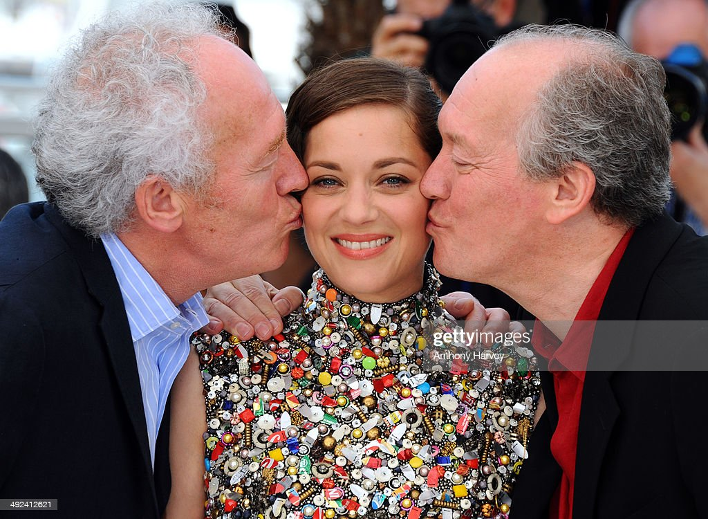 Director Jean-Pierre Dardenne, actress Marion Cotillard and director Luc Dardenne attend the 'Two Days, One Night' photocall at the 67th Annual Cannes Film Festival on May 20, 2014 in Cannes, France.