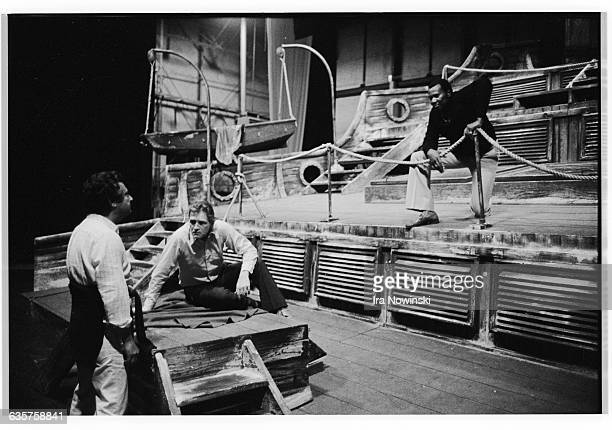 Director, Jean-Pierre Ponnelle discusses with Simon Estes his performance as the Dutchman in the opera. A colleague of the theater listens to...