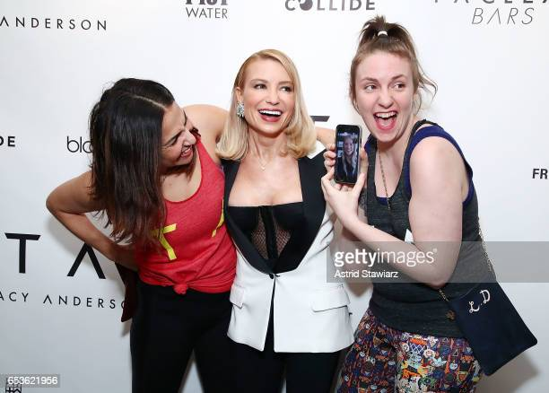 Director Jenni Konner, celebrity trainer Tracy Anderson and actress Lena Dunham hold with an iphone on facetime with actress Gwyneth Paltrow during...