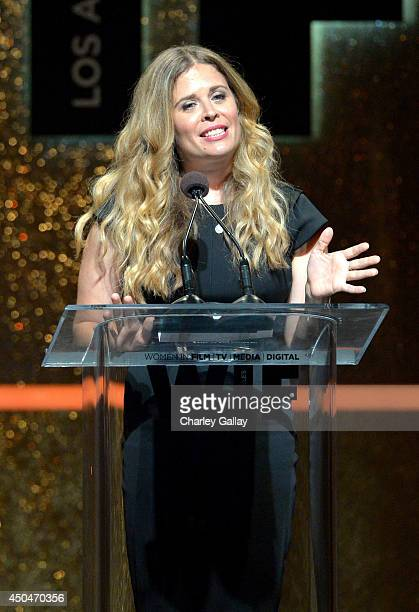 Director Jennifer Lee accepts the Dorothy Arzner Directors Award onstage at Women In Film 2014 Crystal Lucy Awards presented by MaxMara BMW...