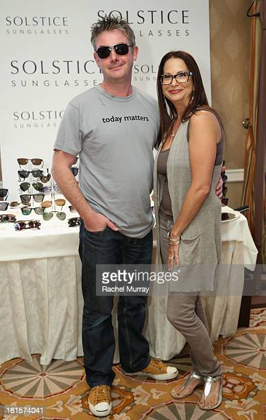2f81fb17b3f32 Director Jeremy Webb in Polaroid X4307 sunglasses poses with Director of  Public Relations of Solstice
