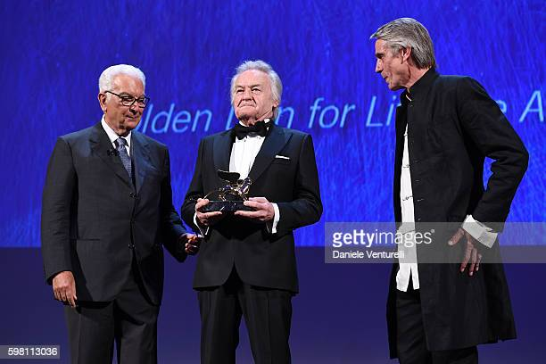Director Jerzy Skolimowski is awarded with the Golden Lion for the carrer by the president of the festival Paolo Baratta and actor Jeremy Irons...