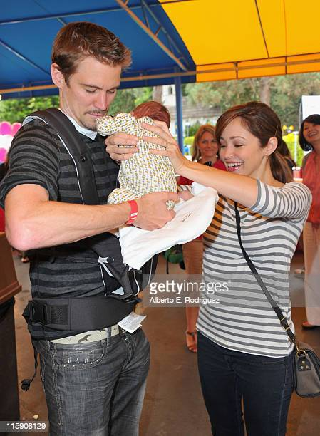 Director Jesse Warren actress Autumn Reeser and son Finn attend a preFather's Day Mini Golf Open celebrating the summer launch of the Britax Baby...