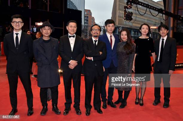 Director Jian Liu composer David Liang and producer Yang Cheng attend the 'Have a Nice Day' premiere during the 67th Berlinale International Film...