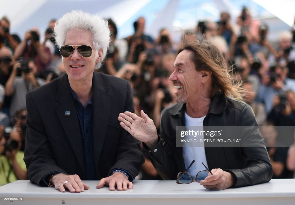 TOPSHOT - US director Jim Jarmusch (L) and US singer Iggy Pop pose on May 19, 2016 during a photocall for the film 'Gimme Danger' at the 69th Cannes Film Festival in Cannes, southern France. /