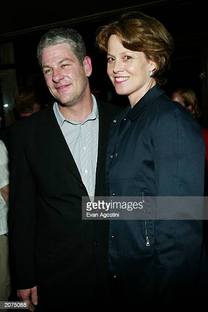 Director Jim Simpson and wife Sigourney Weaver attend MCC Theaters' opening night of Intrigue With Faye afterparty at West Bank Cafe June11 2003 in...
