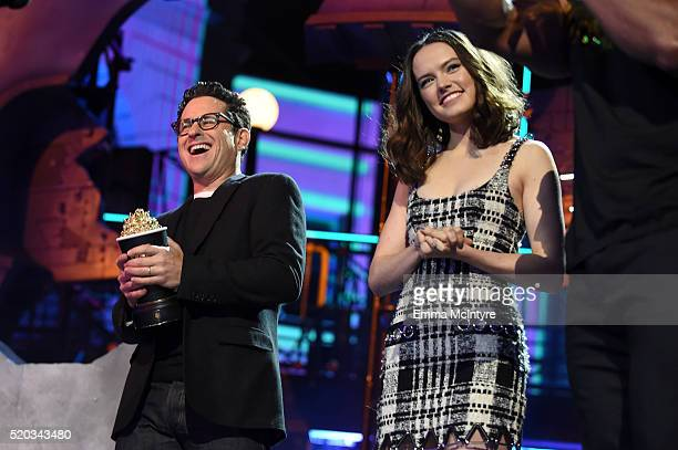 Director JJ Abrams and actress Daisy Ridley accept the Movie of the Year award for 'Star Wars The Force Awakens' onstage during the 2016 MTV Movie...