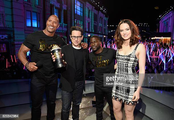Director JJ Abrams and actress Daisy Ridley winners of the Movie of the Year award for 'Star Wars The Force Awakens' pose with hosts Dwayne Johnson...