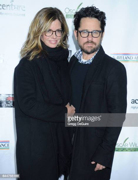 Director JJ Abrams and Katie McGrath arrive at the 12th Annual Oscar Wilde Awards at Bad Robot on February 23 2017 in Santa Monica California