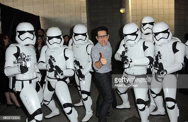 Director JJ Abrams poses with Imperial Stormtroopers at the Lucasfilm panel during ComicCon International 2015 at the San Diego Convention Center on...