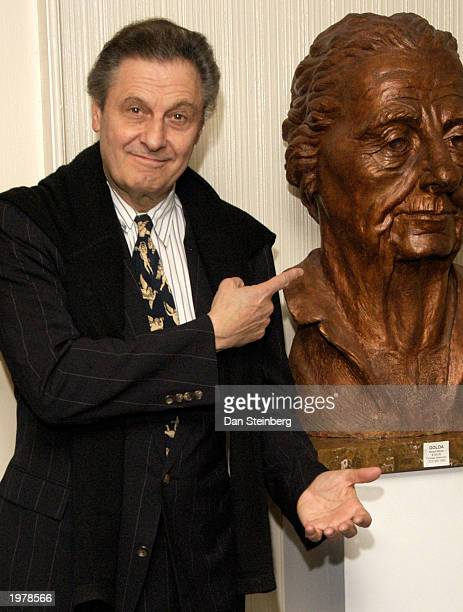 Director Joe Bologna points at a bust of Golda Meir as he arrives at the opening night of the play 'An Evening With Golda Meir' at The Canon Theatre...