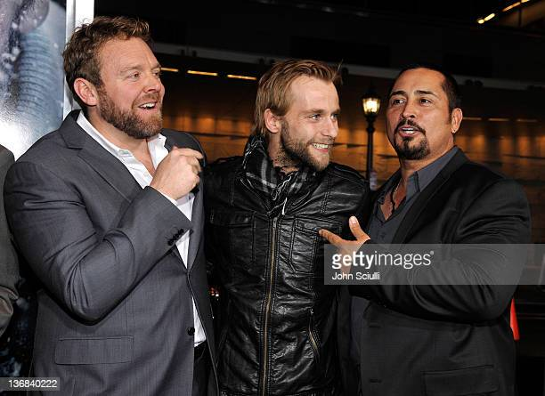 Director Joe Carnahan and actors Joe Anderson and Benjamin Bray attend Open Road Films' The Grey movie premiere at Regal Cinemas LA Live on January...