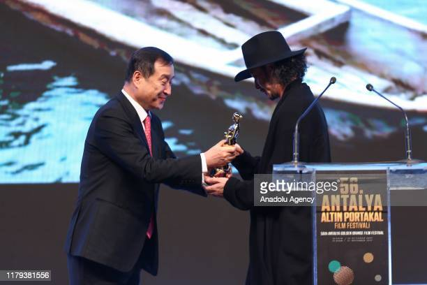 Director Joe Odagiri receives the Best Movie Award at the awards ceremony of the 56th Antalya Golden Orange Film Festival in Antalya Turkey on...