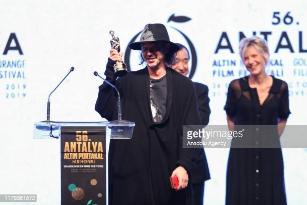 Director Joe Odagiri speaks after receiving the Best Movie Award at the awards ceremony of the 56th Antalya Golden Orange Film Festival in Antalya...