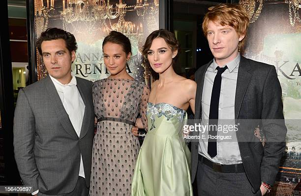 Director Joe Wright actress Alicia Vikander actress Keira Knightley and actor Domhnall Gleeson attend the premiere of Focus Features' Anna Karenina...