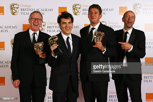 Director Joe Wright poses with the award for Best Film Atonement in the Press Room during at the Orange British Academy Film Awards at the Royal...