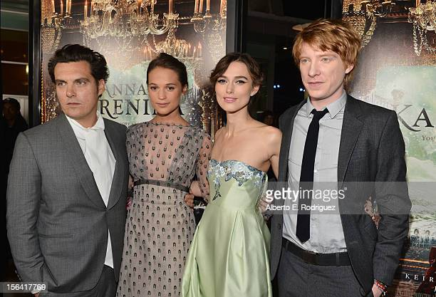 Director Joe Wright with actors Alicia Vikander Keira Knightley and Domhnall Gleeson attend the premiere of Focus Features' Anna Karenina held at...